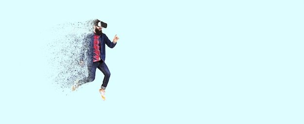 Full length portrait of a jumping bearded hipster in glasses of virtual reality