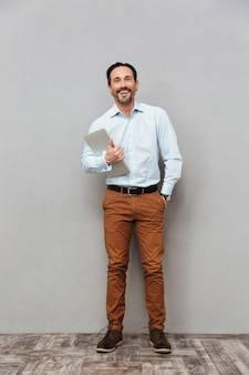 Full length portrait of a laughing mature man