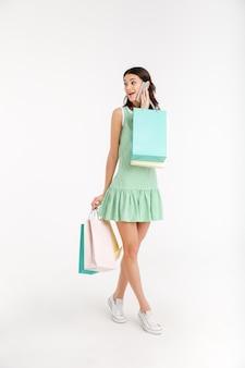 Full length portrait of a lovely girl in dress