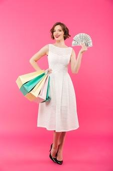 Full length portrait of a lovely girl dressed in dress