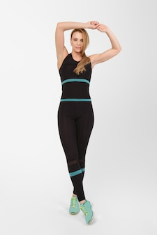 Full length portrait of middle age woman doing exercises