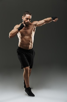 Full length portrait of a motivated muscular sportsman