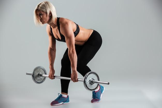 Full length portrait of a muscular adult sportswoman