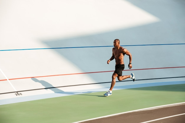 Full length portrait of a muscular half naked sportsman