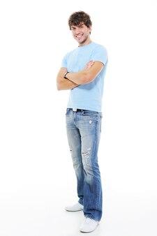 若い筋肉の笑顔のハンサムな男の全身像
