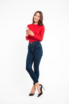 Full length portrait of a pretty smiling asian woman