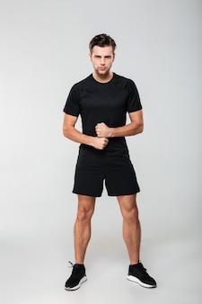 Full length portrait of a serious confident sportsman