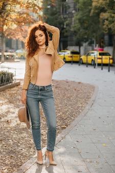 Full-length portrait of shapely ginger woman spending time in park