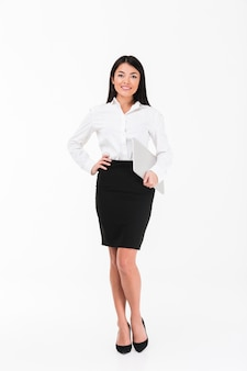 Full length portrait of a smiling asian businesswoman