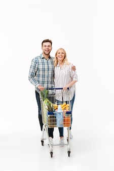 Full length portrait of a smiling couple standing