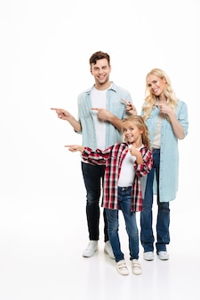 Full length portrait of a smiling family with a child