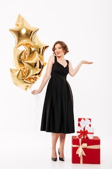 Full length portrait of a smiling girl dressed in dress