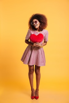 Full length portrait of a smiling happy afro american woman