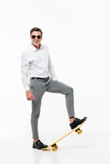 Full length portrait of a smiling man in white shirt
