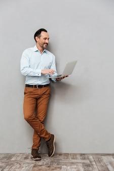 Full length portrait of a smiling mature man