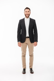 Full length portrait of a smiling young man