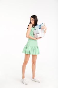 Full length portrait of a upset girl dressed in dress