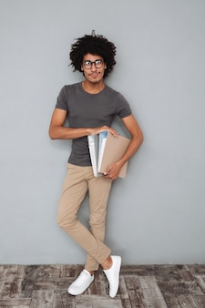 Full length portrait of a young afro american man