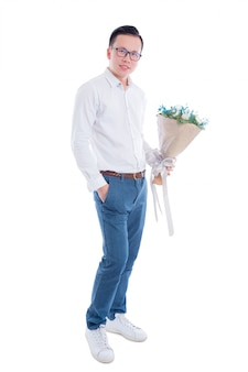 Full length portrait of young asian man holding flowers