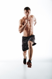 Full length portrait of young attractive runner in motion
