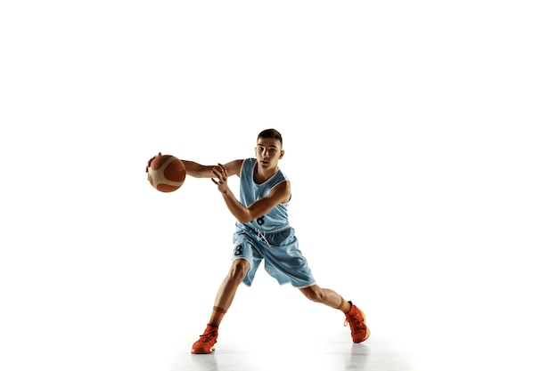 Full length portrait of young basketball player with a ball isolated on white studio background. teenager training and practicing in action, motion. concept of sport, movement, healthy lifestyle, ad.