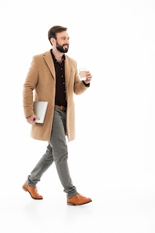 Full length portrait of a young bearded guy