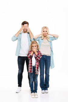 Full length portrait of young family