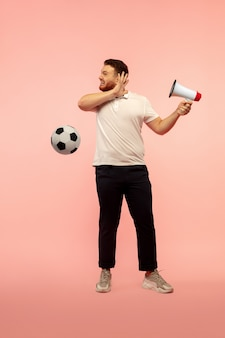 Full length portrait of young high jumping man isolated on pink  wall. male caucasian model. copyspace. human emotions, facial expression, sport concept.