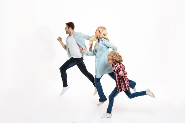 Full length portrait of a young modern family