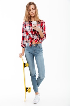 Full length portrait of a young pretty girl in plaid shirt