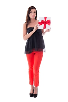 Full length portrait of young woman with gift box isolated on white background