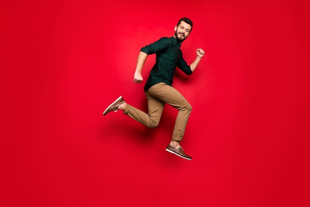 Full length profile side  of positive cheerful  guy jump run after black friday sales wear brown outfit sneakers