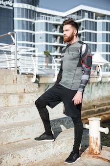 Full length runner near the sea.