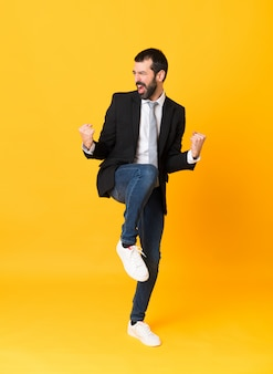 Full-length shot of business man over isolated yellow