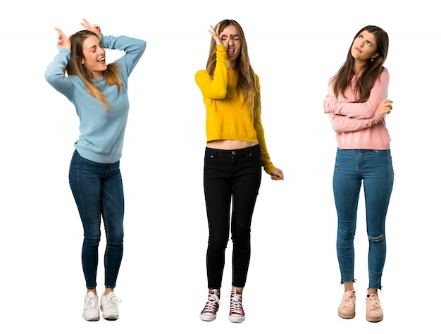 A full-length shot of a group of people with colorful clothes makes funny and crazy face e