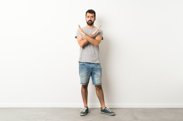 A full-length shot of handsome man with beard making no gesture