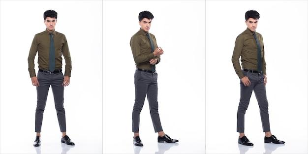 Полная длина оснастки, молодой кавказский деловой человек в костюме с темно-зеленой рубашкой, галстуком, брюками и черными туфлями, у него уверенная прогулка, счастливая улыбка, сильная, коллажная группа на белом фоне, изолированные