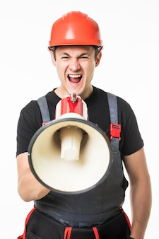 Full length of worker speaking into megaphone isolated over white background