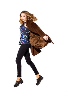 Full length the young long-haired girl jumping in studio. isolat
