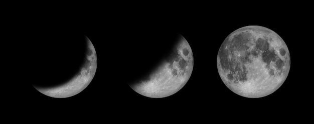 Полнолуние и фаза полумесяца изолируют на черном космосе и показывают отражение гравитации затмения на поверхности луны