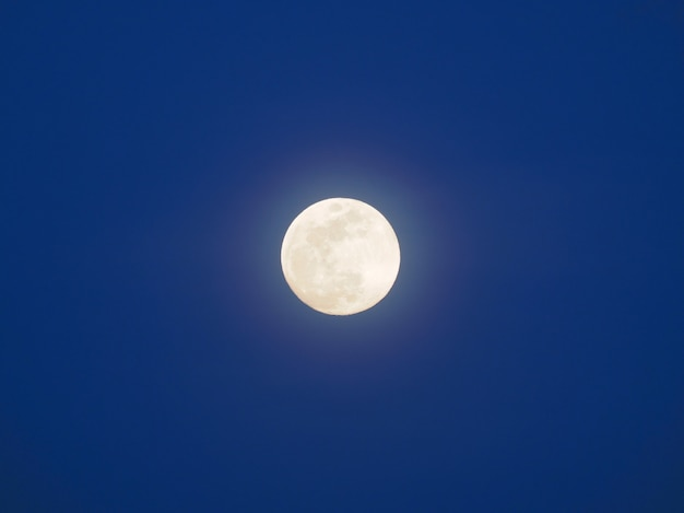 Full moon in a blue sky. the blue hour.