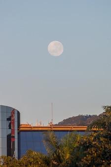 Full moon over a building on botafogo beach in rio de janeiro, brazil.