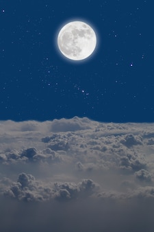 Full moon  over cloudscape