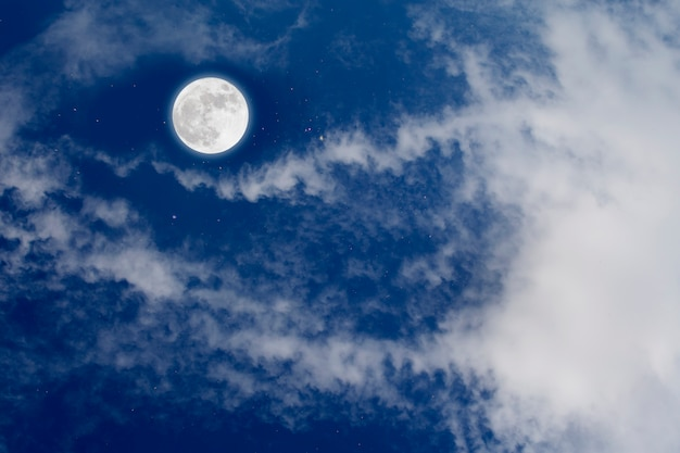 Full moon with starry and clouds background. romantic night.