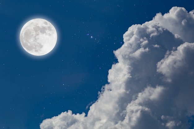 Full moon with starry sky and clouds