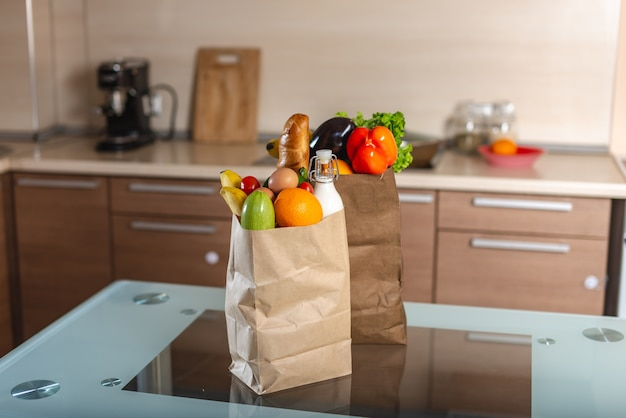 Full paper bags with foods on the table