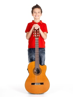 Full portrait of  caucasian boy with acoustic guitar -