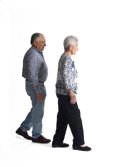Full portrait couple walking on a white background