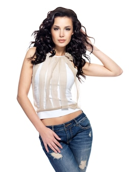 Full portrait of fashion model with long hair dressed in blue jeans