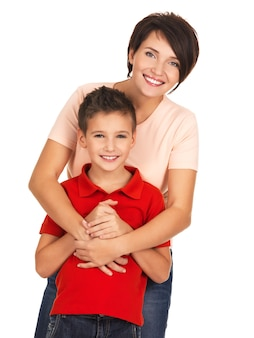Full portrait of a happy young mother with son 8 year old over white wall